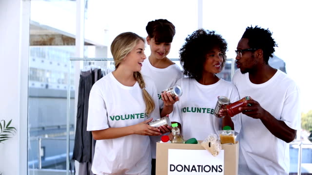 Volunteers watching the food in donation box video