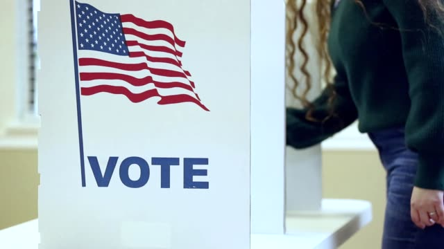 LV Voters rotating in and out of the booth in a USA election. video