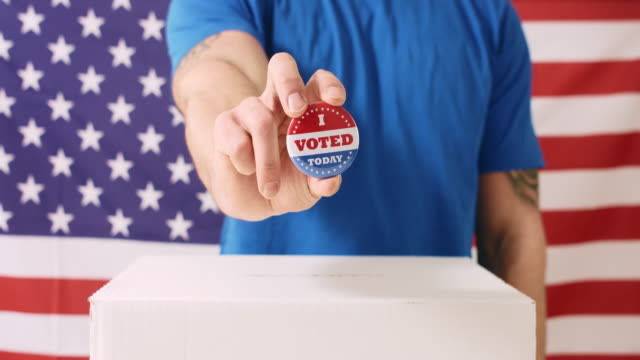 Voting hand on American flag