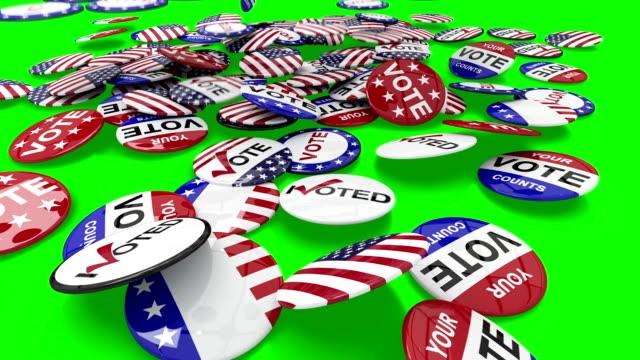 vídeos de stock, filmes e b-roll de votação bótons cair no chão - pin