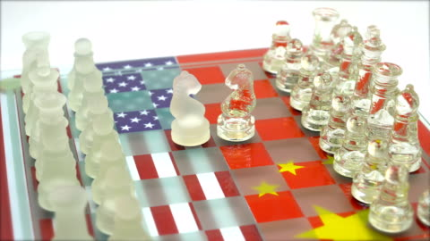 USA vs CHINA Chess board game pieces on USA and China flag background 4K 3840x2160 / 29.97p / Photo-JPEG / Real Time / usa stock videos & royalty-free footage
