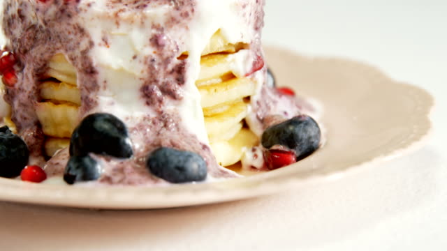 Waffle ice cream garnish with fruits placed on plate 4K 4k video