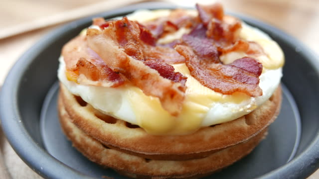 Waffle with bacon and eggs Waffle with bacon and eggs bacon stock videos & royalty-free footage