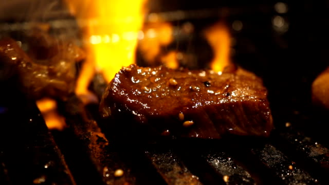 d3c769019215 wagyu premium beef grill with flame background. Izakaya japan style meat  grill. video