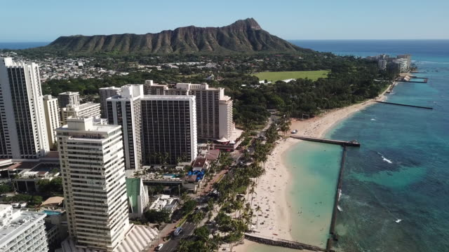 Waikiki and Diamond Head From Above 4k drone shot of Waikiki and Diamond Head in Oahu. waikiki stock videos & royalty-free footage