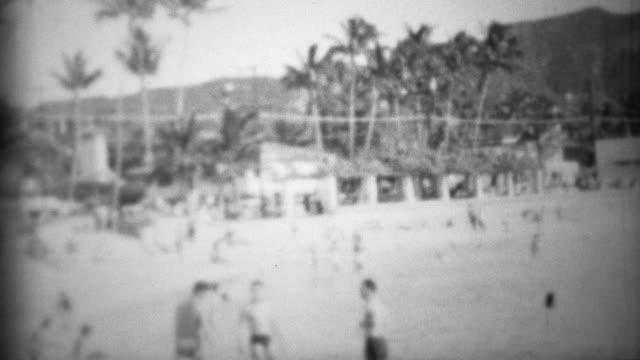1953: Waikiki beach underdeveloped diamondhead visitors playing.