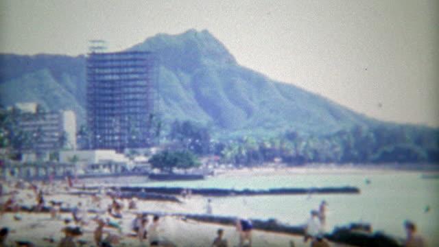 1966: Waikiki beach view of high rise hotel construction and Diamond Head volcano. video