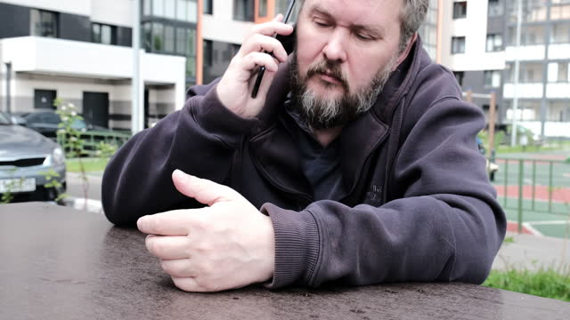 Waist-up portrait of mature man waiting in residential district video
