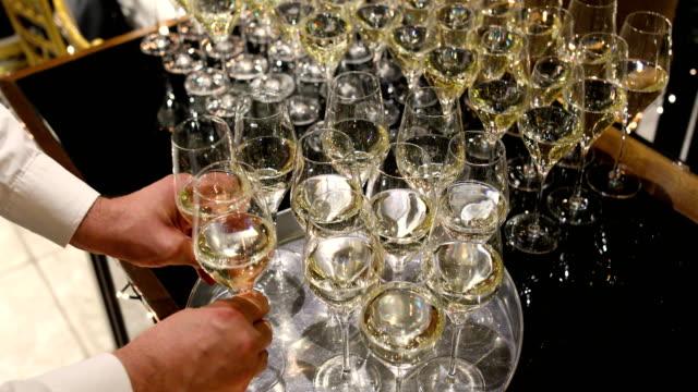 waiter in uniform serving champagne - taca filmów i materiałów b-roll