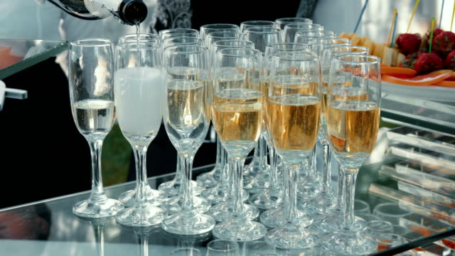 waiter pouring champagne for reception - fine dining stock videos and b-roll footage