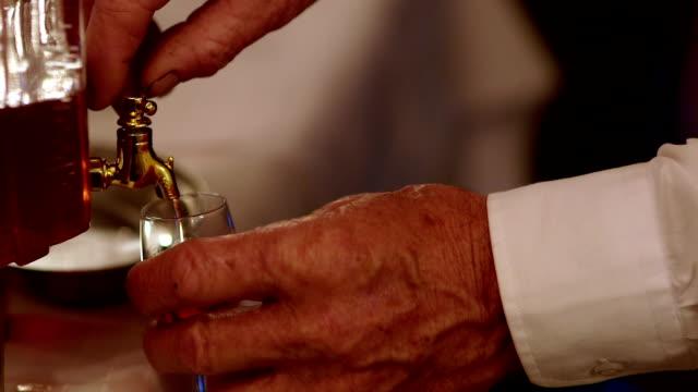CLOSE UP Waiter pouring liqueur into glass video