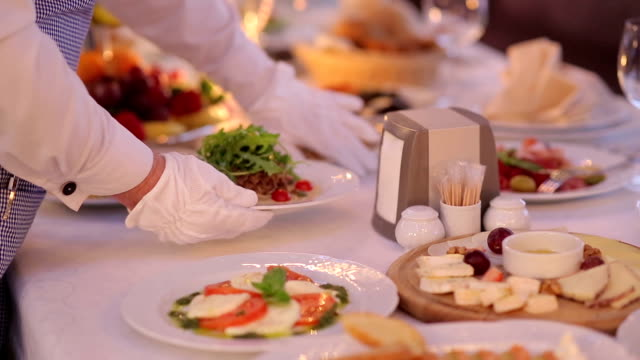 Waiter Serves  Banquet Table video
