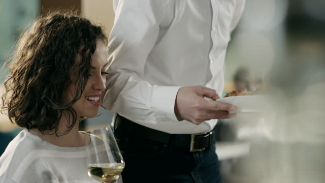 Waiter serving dinner to women on date in restaurant video
