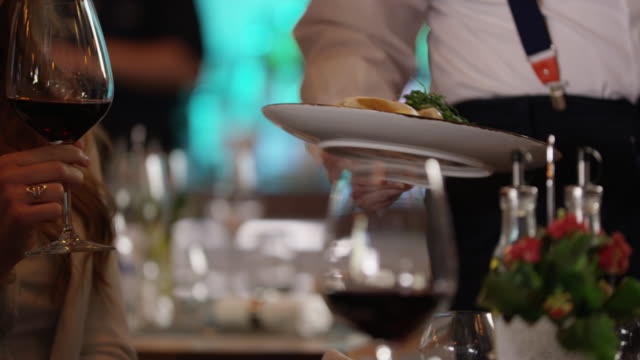 Waiter Serving Dish 4K slow motion Close up shot of serving dish at the restaurant. Video shot with Red Raven 4K. wait staff stock videos & royalty-free footage