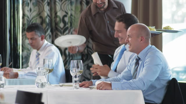 HD: Waiter Serving Food To Two Young Managers video