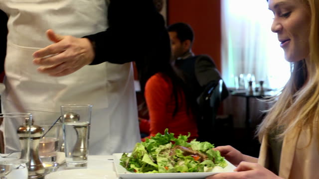 Waiter Serving Salad Meal to Couple video