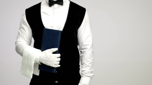 Waiter with a menu and a towel video