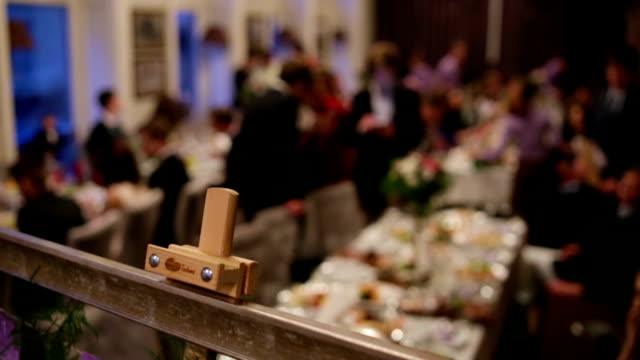 Waiters serving table in a wedding  ceremony for guests and a bride and her groom. video