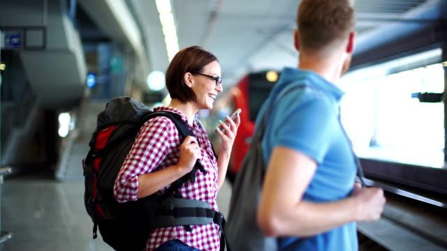 waiting for a train. - турист с рюкзаком стоковые видео и кадры b-roll
