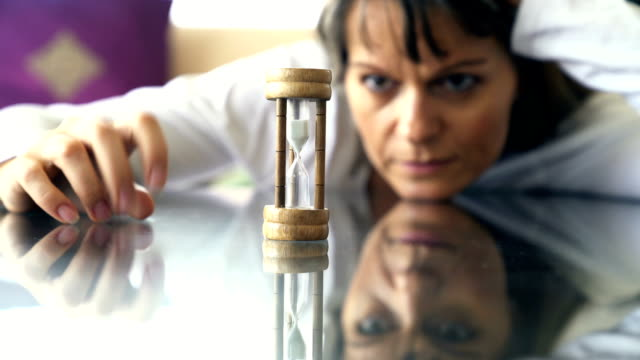 Waiting Woman is impatiently watching an hourglass impatient stock videos & royalty-free footage