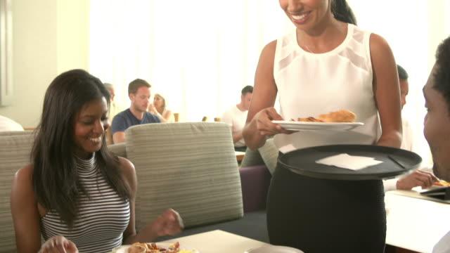 Waitress Serving Couple Breakfast In Hotel Restaurant video
