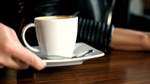 Waitress Serving Hot Coffee in Restaurant video