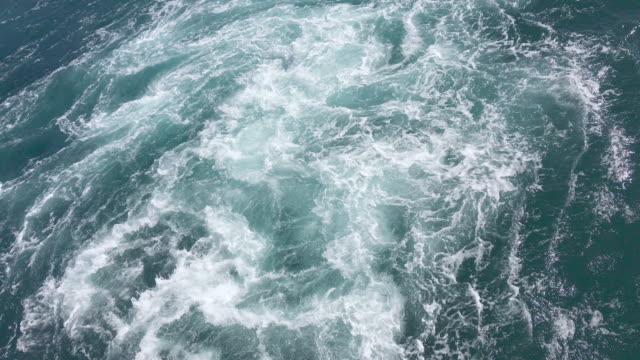 Wake behind big ferry