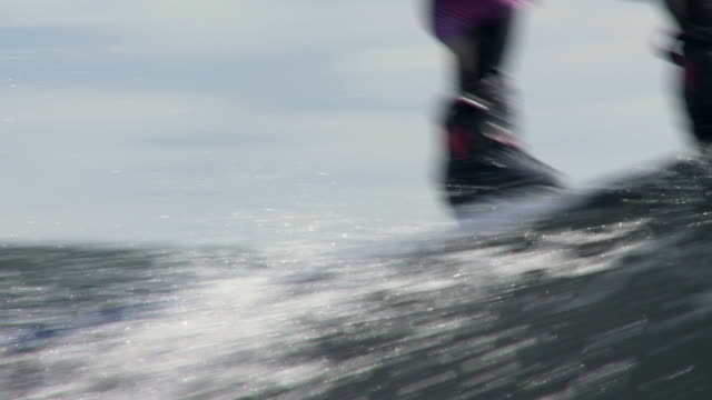 Wakeboarder on lake in slow motion Close-up of young man wakeboarding on lake in slow motion (HD, NTSC).     wasser videos stock videos & royalty-free footage