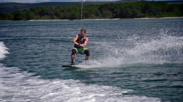 Wakeboarder performing a trick video