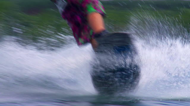 SLO MO Wakeboarder Riding On Lake Young man wakeboarding on lake in slow motion.   wasser videos stock videos & royalty-free footage