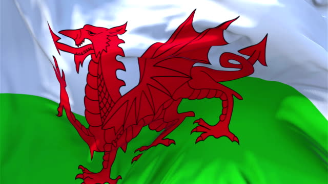 Wales Flag Waving in Wind Slow Motion Animation . 4K Realistic Fabric Texture Flag Smooth Blowing on a windy day Continuous Seamless Loop Background.