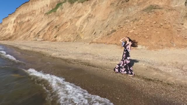 walk along the beach. happy young woman. aerial view. - prom fashion stock videos and b-roll footage
