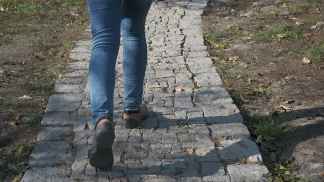 walk along the old cobblestones. - nazionalità russa video stock e b–roll