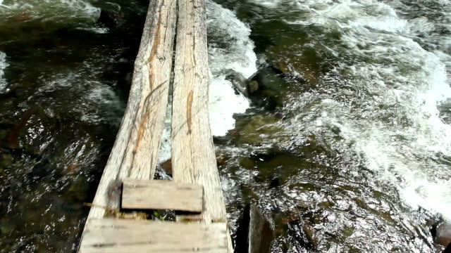 Walking along a boardwalk over  river video