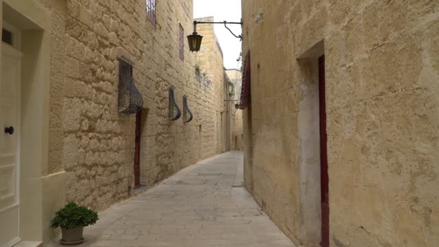 Walking along the medieval streets of old Mdina, Malta. Mdina is populer tourist destination in Malta. Walking along the medieval streets of old Mdina, Malta. Mdina is populer tourist destination in Malta malta stock videos & royalty-free footage