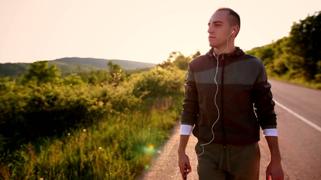 Walking and listening music outdoors video