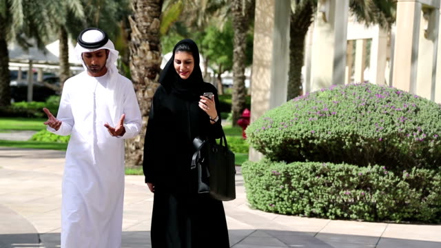 Walking Arab man and woman in traditional clothing video