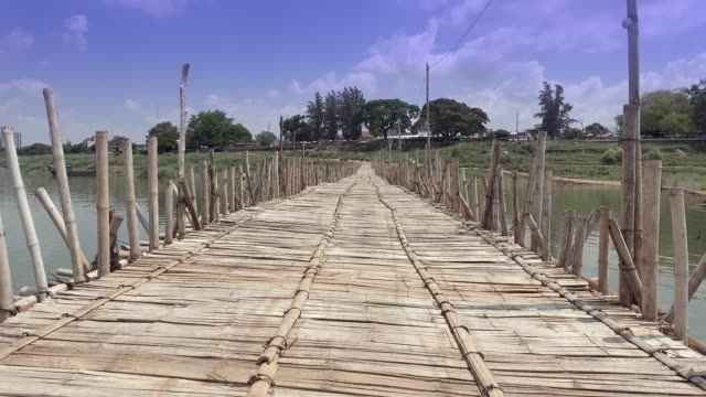(POV ) walking back on the bamboo bridge over the river video