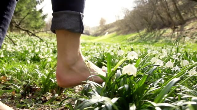 HD SUPER SLOW-MO: Walking Barefoot Over Spring Snowflakes video