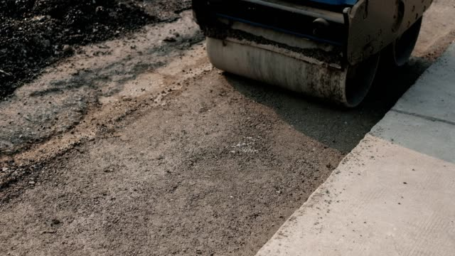 Walking compaction compacted for use in heavy industry, road work Walking compaction compacted for use in heavy industry, road work construction vehicle stock videos & royalty-free footage