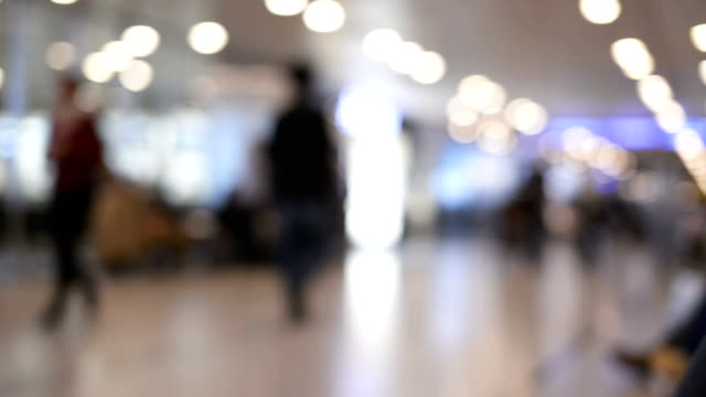 Walking defocused people at the airport. video