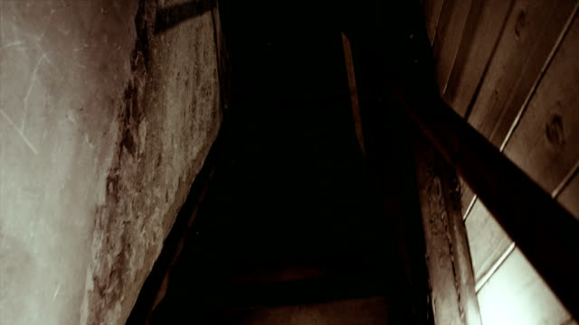 Walking down the spooky stairs in a haunted house.