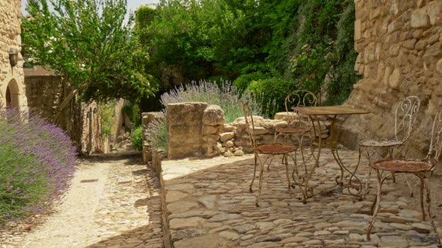 Walking down the street in Lacoste - a commune and medieval village in the southern France. 4K, UHD
