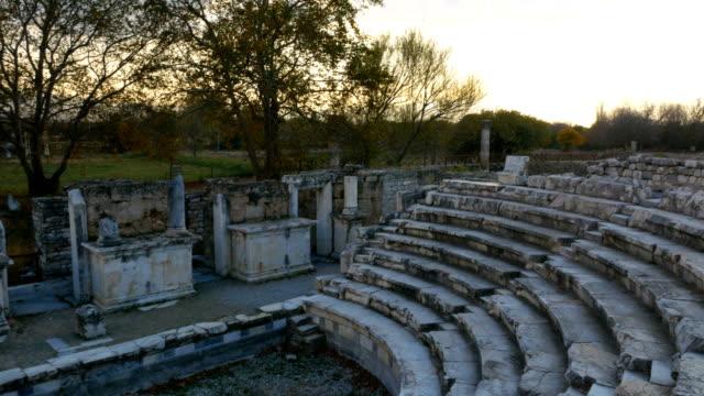 walking in amphitheatre  of aphrodisias antique city - mitologia video stock e b–roll