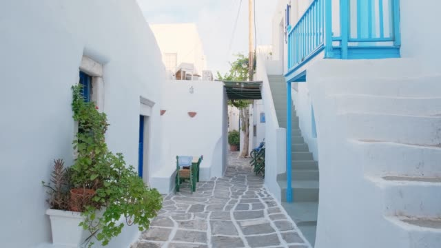 Walking in Naousa street on Paros island, Greece