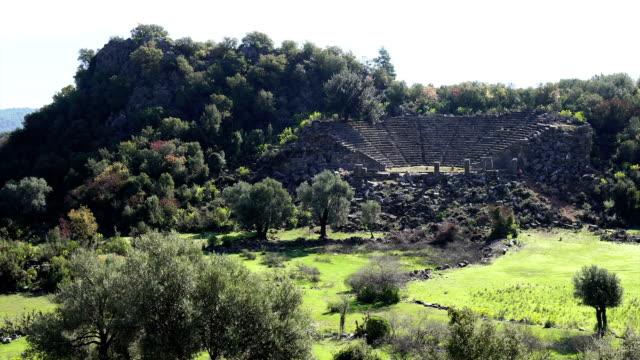 walking in the ancient city of pinara. pinara, fethiye, turkey. - mitologia video stock e b–roll