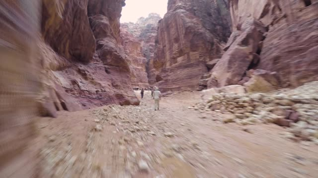 Walking Inside Canyon in Ancient City of Petra Hyperlapse of walking through the canyon in ancient city of Petra towards the treasury. treasury stock videos & royalty-free footage