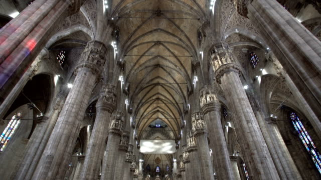 walking inside the milan cathedral - gothic architecture stock videos & royalty-free footage