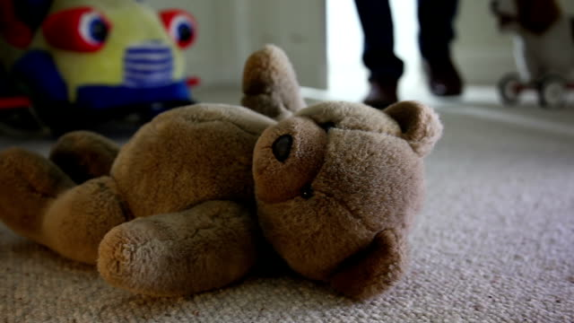 Walking into a child's bedroom at night, toys on floor. video