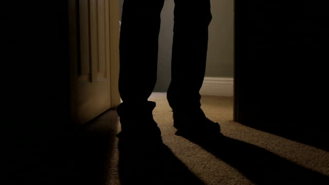 Walking into a room at night, shadows. video